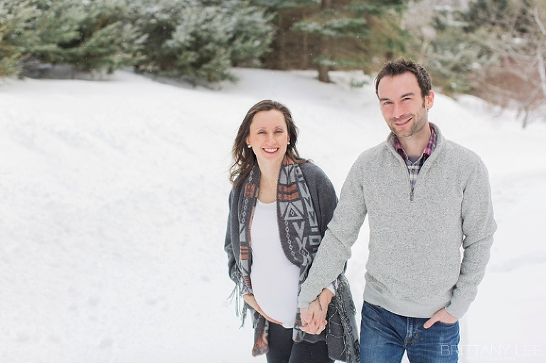 Mont Tremblant Winter Maternity Photos - couple walking on path