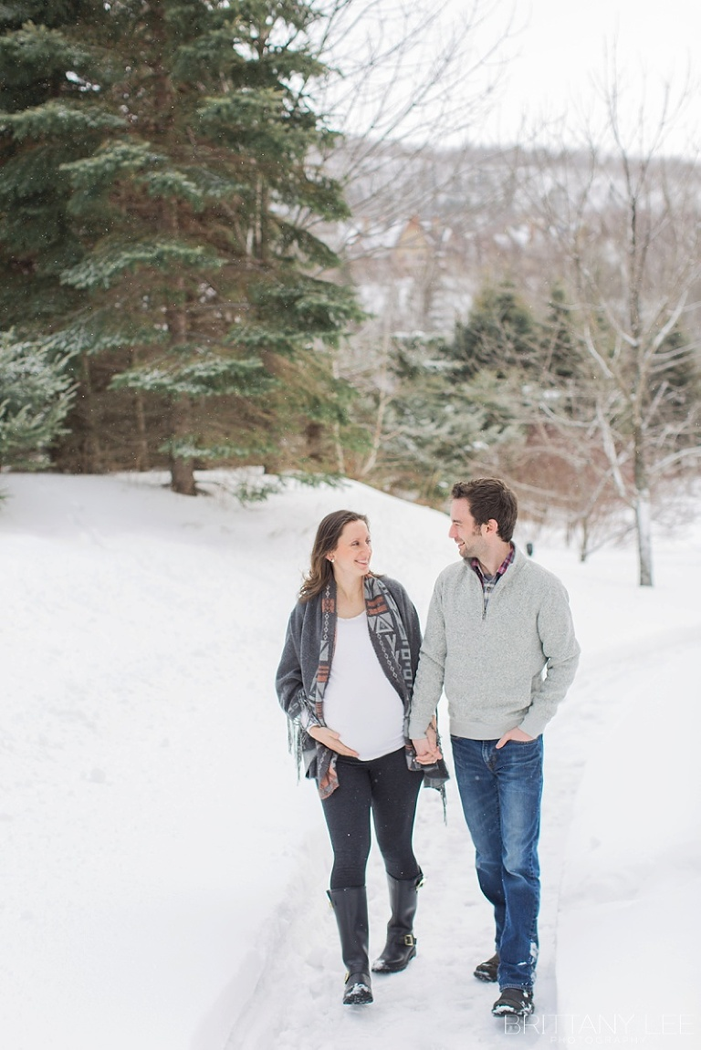 Mont Tremblant Winter Maternity Photos - couple walking down snowy path