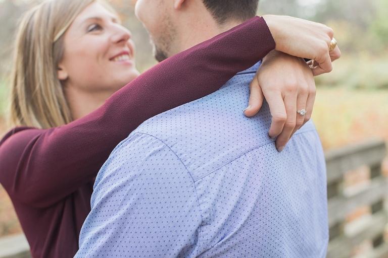 Stonebridge Trail Fall Engagement Session - Bride and Groom on walking bridge