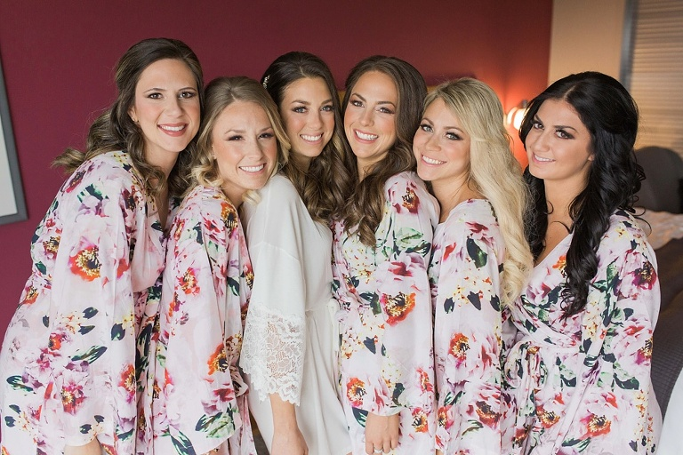 Brookstreet Hotel Ottawa Fall Wedding - Bridesmaids in pink floral robes getting ready